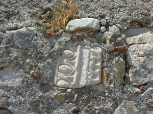 Ancient carving used as filler in castle wall